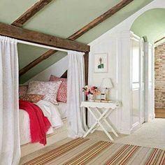 Angled Attic Bed - I like how the bed is tucked in the corner and how they put the curtain in front of it!