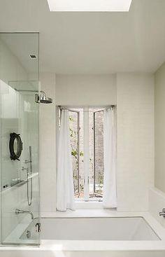undermount tub with folding glass enclosure