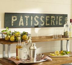 "Patisserie Sign #potterybarn        Like the familiar signs fronting Parisian bakeries, this one has a weathered look and evocative character.          45"" wide x 8.25"" high x 1"" thick         Made of pine.         Distressed hand-painted finish.         Mounting hardware included.  129.00"