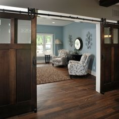Great idea with old doors for any room. The simple pattern upholstery really pops on the great floors & simple natural sisal rug. We can pretty much do this whole thing for you!   original idea to seperate the space (especially my home office!)