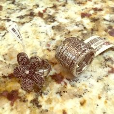 TWO rings, one size fits most, stretchy! Never worm, tags still on! You get two! Jewelry Rings
