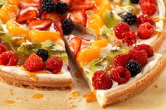 One of my favorite recipes :) Mom always made these for parties. So easy! Press sugar cookie dough into pizza crust, bake according to package directions. Let cool. Combine a mixture of cream cheese, vanilla, and sugar, then spread over crust. Arrange any kind of fruit you want, and then finish with a topping of orange marmalade/water mixture. Done!
