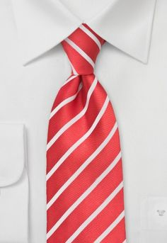 Striking men`s tie with delicately structured stripes in pearly white on a background held in fashionable medium red. http://www.mens-ties.org/slim-stripes-p-14947.html
