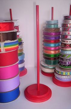 Ribbon spool organizer ~ take it further for my collection, drill holes in a lazy susan and mount the dowels.