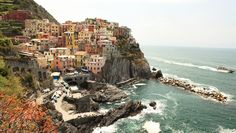 Manarola, Cinque Terre, Italy. Cinque Terre is made up of 5 small towns along the coast of the Ligurian sea. It's a world heritage site. No cars are allowed inside and you get from town to town by train, boat or the hiking trails that connect the towns. One of my favourite places I've ever been to. Photo by Jessica Zais