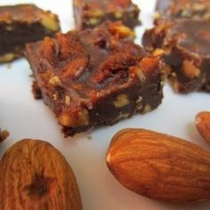 Paleo Energy Bars 1 jar of almond butter with flax from trader joes  1/2 cup of shredded coconut  1/2 cup of crushed pecans  1/2 cup of roasted pepitas (the green interior of a pumpkin seed)  1/2 cup of almond slivers  2 tablespoons of organic cocoa powder  2 tablespoons of raw honey