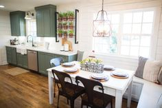 The kitchen was already equipped with a perfect-sized eat-in space, so we simply updated and highlighted it by adding bench seating by the window and a modern chandelier. We also carried the shiplap from the formal dining room into this space to help define it from the kitchen.