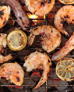 Everything in this dish is grilled -- even the lemon slices, which you can treat as a garnish or nibble on with the shrimp. Grilling the shrimp in their shells helps them retain their flavor and keeps them from being overcooked. Another tip: Relegate the bacon to the cooler areas of the grill, since the flames will flare up as the fat drips.