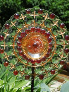 GARDEN stakes and YARD sun catcher made with recycled glassware