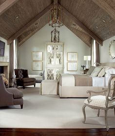 Bedroom with soft tones, fireplace and vaulted ceiling  #bedroom #fireplace #vaultedceiling