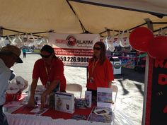 sales team spreading the word of safe security service at The Big Fresno Fair.