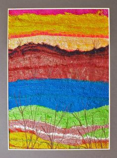 Sunset - Created using recycled sari silk strips on a cotton base. Machine embroidery used to add the bushes in the foreground