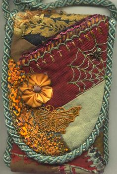 I ❤ embroidery & crazy quilting . . . Two other people on the Crazy quilters list have the same birthday as me, Janis and Bette Kosmolak. This is the front of a pouch we did as a round robbin. ~by Sharon B., Pin Tangle