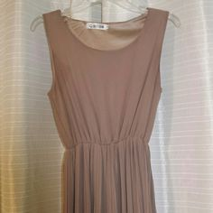 Pretty chiffon dress Tan color Was bought in Japan Size medium in Japan, size small in U.S. Worn couple times, still looks like new, no stains or tears Reaches about 2-3 in above knee Dresses