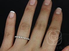 This simple yet interesting design is a must have classic! This ring is a slight twist the classic diamond eternity band! All stones used are only premium cut, fairly traded, and/or conflict-free! Our diamonds are always natural NEVER treated or enhanced for better color or clarity. Our