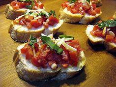 Bruschettas de tomate, alho e manjericão