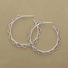 Our exclusive sterling beaded hoop earrings charm with their delicate design.