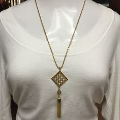 """New Tory Burch long gold tone tassel necklace GORGEOUS! Brand New WITH OUT tags- Tory Burch long gold tone tassel necklace with Tory Burch logo centered. 32"""" Chain Length. RETAIL $125- will ship in little purple Tory Burch Jewelry Pouch! Tory Burch Jewelry Necklaces"""