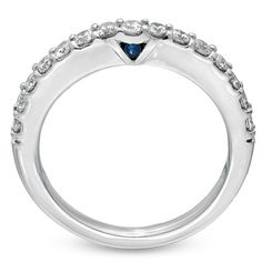 Love this Vera Wang wedding band with the hidden sapphire which is a symbol of faithfulness and everlasting love