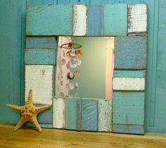 bathroom mirror.  Would also look cool in L & A's bathroom. Would be fairly easy to make... just stencil-brush scraps of thin wood (pallet planks?) and line up around mirror & add a cute embellishment.