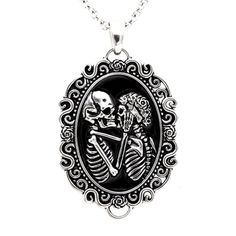 Possess Eternal Love: http://www.inkedshop.com/womens-eternal-lovers-skull-cameo-necklace-controse-silver.html