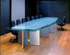 custom large glass top conference tables and office furniture with textured metal or wood bases integrated wiring and stone or glass tops built in the usa blue glass top modern office