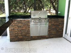 The stone faux panels® in this outdoor kitchen are able to withstand the elements of weather and extreme heat.