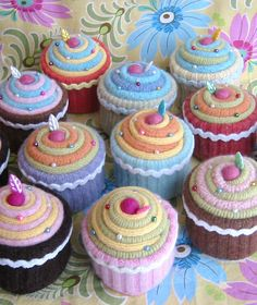 cupcake pincushions ... looks like they are made from cuffs from felted sweaters ...