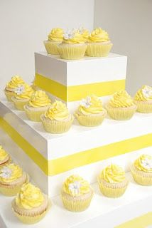 Lemon yellow cupcakes make a cute and convenient alternative to a traditional wedding cake.