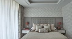 Upholstered headboard, integrated nightstands, drapery panels over sheers installed in drapery pocket
