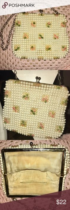 "Vintage 1950s White Clear Beaded Pink Floral Purse Lovely circa 1950's purse is crafted from white and clear beads that create a bubble-like texture on top of a soft, flexible pink floral printed canvas. A silver-tone metal kiss-lock clasp secures your treasures inside. The spacious interior features one 4""H x 2"" W pocket. A 12"" drop silver-tone chain makes carrying this purse stylish  & easy! Purse measures 8""H x 10""W. It is in very good condition with no missing beads or discoloration. The…"