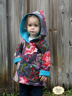 Easy to sew hooded jacket sewing pattern. Comes with many sizes and ruffle option! It's even reversible!!