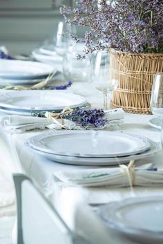 Love the lavender theme on the napkins and centerpiece w/ white place settings. very country french.