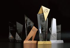 This series of trophy design was combined with metal and crystal ,use these two different materials to make the figure more outstanding and unique. Trophies And Medals, Custom Trophies, Acrylic Trophy, Plaque Design, Trophy Design, Award Plaques, Wayfinding Signage, Stage Design, Booth Design
