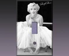 I just bought this for my room!   Found this at Etsy listing at https://www.etsy.com/listing/161796361/light-switch-cover-marilyn-monroe