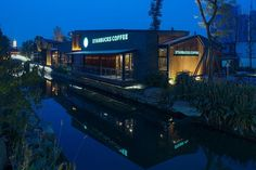This unique Starbucks comprises two free-standing buildings boasting scenic river views. All of the yes to drinking (and photographing) your iced green tea while looking at the river.