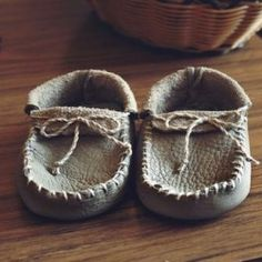 Learn how to make moccasins just like the native americans did. - this one seems a little more confusing in the instructions but I think it might work, too, but I'd want to sew a liner along the bottom before sewing it all together for stability since it is just one piece of leather