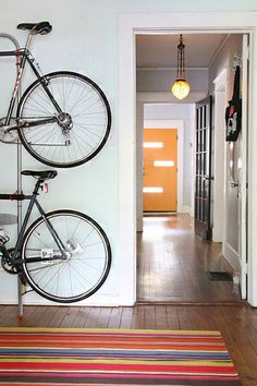 Sometimes you need to find creative ways to store your stuff. Think vertically and use wall space to store your bikes.
