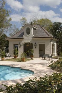 Mediterranean Swimming Pool with Pathway, exterior stone floors, Pool house, Fence