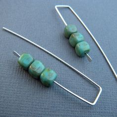 silver turquoise earrings. glass beads. dangle sterling silver earrings. beaded. $22.00, via Etsy.
