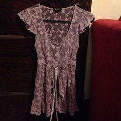 Forever 21 lace shirt Forever 21 lavender lace top, size small. This top is beautiful. Short sleeves and buttons down the chest, after the buttons there is a tie around the bottom of the chest, the rest of the shirt around the stomach is flowy and opened. It's very cute and flattering (: Forever 21 Tops