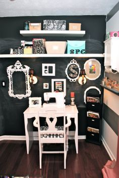 Stunning craft room! love her chalkboard wall and use of frames.