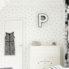 Polka dot walls are a must-do. Plus LOVE the single simple initial on the wall