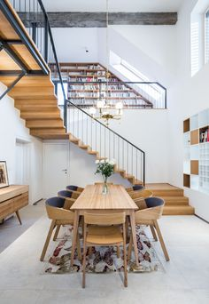 ARCHHOLIKS with MIMOArchitekti Dinning room like a central hall with staircase and special atmosphere. Stairway Walls, Stairs, Staircase In Living Room, Central Hall, Courtyard House Plans, Luxury Kitchen Design, Room Kitchen, Dining Room, Furniture