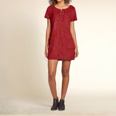 Girls Faux-Suede Shift Dress | New favorite dress in supersoft faux-suede fabric with an easy silhouette, a strappy lace-up front closure with two front pockets, finished with a zipper closure at back, Easy Fit | HollisterCo.com