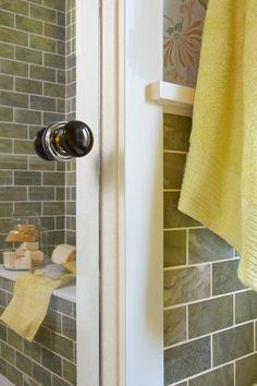 A porcelain doorknob on this glass shower door helps maintain a sense of cohesion and flow with the rest of the home