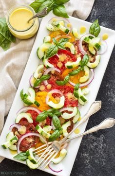 Take advantage of fresh summer produce and make this Heirloom Tomato Cucumber Salad with Peach Vinaigrette! Healthy, fresh and easy to make!