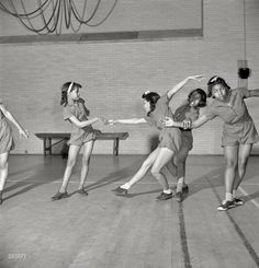 "Danse Moderne: March 1942. Washington, D.C. ""Dancing class at an elementary school."" Expert instruction in both the boogie and the woogie. Medium format nitrate negative by Marjory Collins for the Office of War Information. Click to view full size."