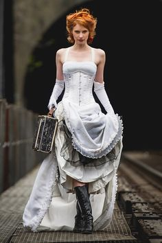 Looking for something to help showcase your fabulous figure on your wedding day? Pick one of our bridal corsets for your wedding dress to flaunt your hourglass figure with steel boned, tight lacing corsets.  Available in white satin, lace, floral patterns, and some with pops of contrasting colors for the more daring, Timeless Trends has high-quality, affordable corsets for your special day. Look fabulous on your wedding day with our bridal corsets.