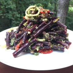 Most purple vegetables lose their color when you cook them but these purple long beans stay a vivid purple. They are deeply savory and provide an earthy counterpoint to the sour roselle leaves in this salad. Purple Long Beans Recipe, Green Bean Salads, Green Bean Recipes, Veggie Side Dishes, Side Dish Recipes, Vegetable Recipes, Vegetarian Recipes, Purple Vegetables
